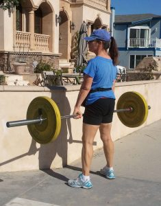 60 year old woman lifts heavy weights