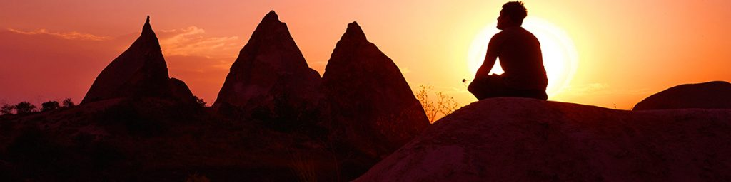 This image has an empty alt attribute; its file name is meditationsunset1200x300-1024x256.jpg